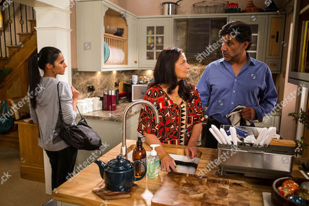 Stock Image of Sharif's guilt-ridden after sleeping with Sonia, as played by Sudha Bhuchar, and when she starts criticising Yasmeen's taste, Sharif Nazir, as played by Marc Anwar, forbids her from mocking his wife. Sonia's chastened but as Sharif places a hand on her back, Alya Nazir, as played by Sair Khan, walks in and clocks their intimacy. (Ep 8994 - Monday 19th September 2016)