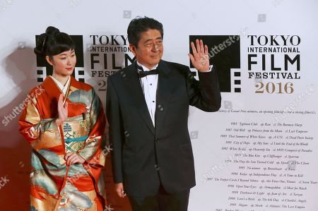 Shinzo Abe, Haru Kuroki Japanese Prime Minister Shinzo Abe, right, and Japanese actress Haru Kuroki pose for photographers as they arrive for the opening ceremony of the Tokyo International Film Festival in Tokyo