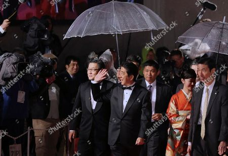 Shinzo Abe, Haru Kuroki Japanese Prime Minister Shinzo Abe, center, accompanied by Japanese actress Haru Kuroki, second right, waves at people upon their arrival for the opening ceremony of the Tokyo International Film Festival in Tokyo