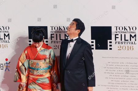 Shinzo Abe, Haru Kuroki Japanese Prime Minister Shinzo Abe, right, looks up while Japanese actress Haru Kuroki looks down before posing for photographers upon their arrival for the opening ceremony of the Tokyo International Film Festival in Tokyo