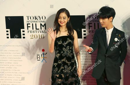 Nozomi Sasaki, Yesung Japanese actress Nozomi Sasaki, left, and South Korean K-pop group Super Junior member Yesung pose for photographers during the opening ceremony of the Tokyo International Film Festival in Tokyo