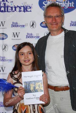 Young author Nadine Foreman holding her book The Royal Crystal with children's author Jeremy Young