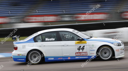 Stock Picture of Andy Neate racing for WSR driving a BMW 320si E90  competing in the training sessions for the British Touring Car Championship, at the Thruxton Race course, Hampshire England.