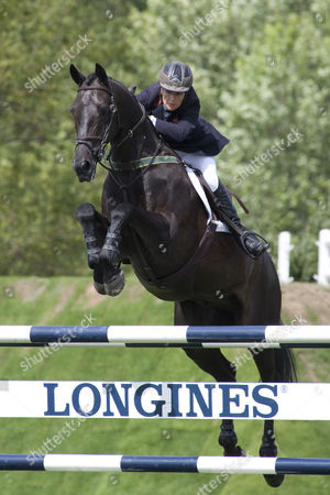 Promised Land ridden by Tina Fletcher competing in The Old Lodge Queen Elizabeth II Cup, during The Longines Royal International Horse Show, held at The All England Jumping Course, Hickstead.