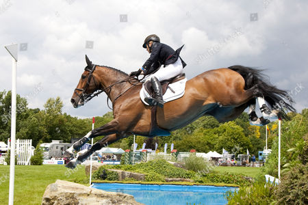UNIQUE IX ridden by Tina  Fletcher (GBR) competing in the Bunn Leisure Derby trial at the British Jump Derby Equestrian meeting held at Hickstead West Sussex England.