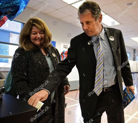 Sherrod Brown, Connie Schultz U.S. Sen. Sherrod Brown, D-Ohio, puts his ballot into the voter drop box as his wife Connie Schultz watches at the Cuyahoga County Board of Elections, in Cleveland. Brown casted his vote early ahead of the Nov. 8 presidential election