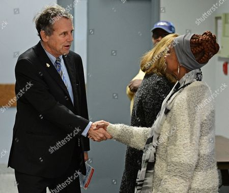 Sherrod Brown U.S. Sen. Sherrod Brown, D-Ohio, shakes hands with a polling station worker as he arrives to cast his vote at the Cuyahoga County Board of Elections, in Cleveland. Brown casted his vote early ahead of the Nov. 8 presidential election