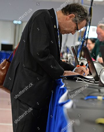 Sherrod Brown U.S. Sen. Sherrod Brown, D-Ohio, fills out the early voting application at the Cuyahoga County Board of Elections, in Cleveland. Brown casted his vote ahead of the Nov. 8 presidential election