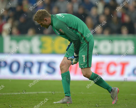 Anders Lindegaard of Preston North End holds his thigh after a clash during the EFL Cup - Fourth Round match between Newcastle United and Preston North End played at St. James? Park, Newcastle upon Tyne on 25th October 2016