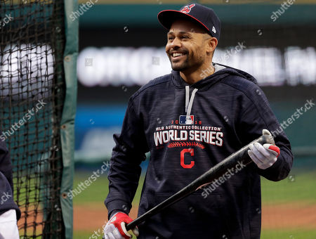Cleveland Indians left fielder Coco Crisp smiles during batting practice before Game 1 of the Major League Baseball World Series against the Chicago Cubs, in Cleveland