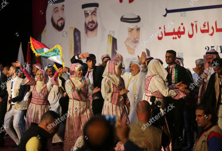 Palestinian brides sing and dance traditional Folklore during a mass wedding celebration ceremony of their wounded grooms who were wounded in the summer 2014 Israel-Hamas war, in Gaza City, . Nineteen Palestinian wounded grooms took part in the mass wedding aided by Sheikh Nahyan bin Mubarak Al Nahyan, United Arab Emirates Minister of Culture, Youth and Community Development
