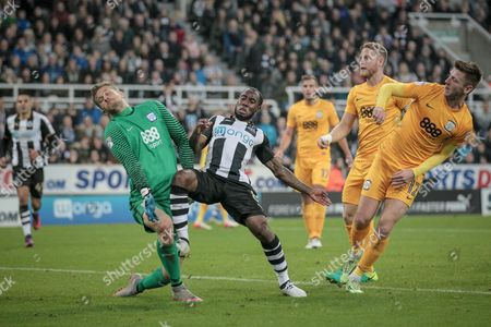 Vurnon Anita (Newcastle United) challenges Anders Lindegaard (Preston North End) during the EFL Cup 4th round match between Newcastle United and Preston North End at St. James's Park, Newcastle