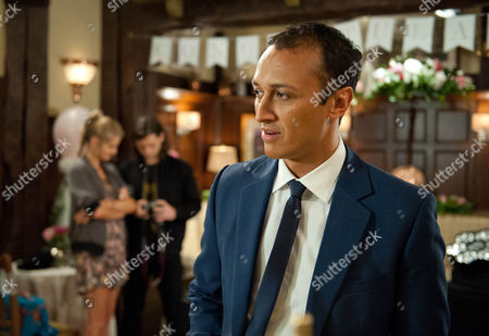 Holly Barton, as played by Sophie Powles, is helping set up at the wedding reception and gets attention from the sound technician, Ben. Jai Sharma, as played by Chris Bisson, sees and is jealous. (Ep 7622 - Thursday 22nd September 2016)