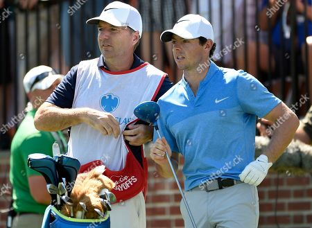 """Rory McIlroy, J. P. Fitzgerald, Barclays Golf In this Aug. 28, 2016 photo, Rory McIlroy of Northern Ireland, right, and his caddy, J. P. Fitzgerald look down the fairway before McIlroy tees off from the first hole during the final round of The Barclays golf tournament in Farmingdale, N.Y.. McIlroy didn't have to check his bank account to know that his FedEx Cup bonus had been deposited. His caddie, J.P. Fitzgerald, informed him with a text message that a 'tsunami' had hit his account. McIlroy paid him a bonus of just over $1 million. """"I think his words were, 'A tsunami just hit my bank account, so thank you very much,'"""" McIlroy said, on the eve of the HSBC Champions"""