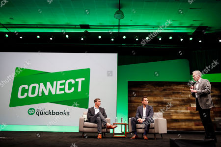 Stock Picture of Michael Phelps, Bill Rancic From left, gold medalist Michael Phelps inspires attendees during a fireside chat with entrepreneur Bill Rancic and Intuit CEO Brad Smith at the third annual QuickBooks Connect on in San Jose, Calif