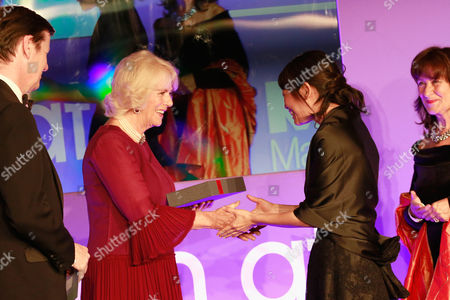 Luke Ellis, Camilla Duchess of Cornwall and Helena Kennedy QC present shortlisted author Madeleine Thien with a copy of her book 'Do Not Say We Have Nothing'