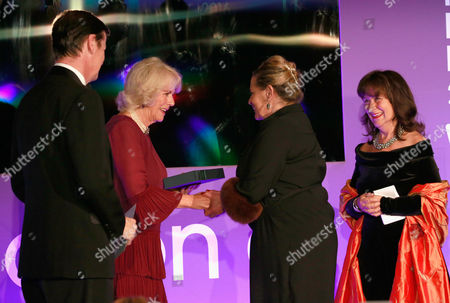 Luke Ellis, Camilla Duchess of Cornwall and Helena Kennedy QC present shortlisted author Deborah Levy with a copy of her book 'Hot Milk'