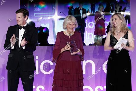 Luke Ellis, Camilla Duchess of Cornwall and Dr Amanda Foreman present the 2016 Man Booker Prize