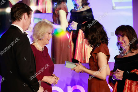Luke Ellis, Camilla Duchess of Cornwall and Helena Kennedy QC present shortlisted author Ottessa Moshfegh with a copy of her book 'Eileen'