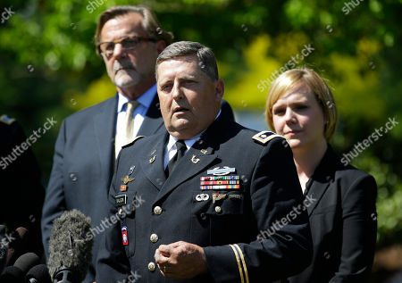 John Henry Browne, Emma Scanlan, Greg Malson Maj. Greg Malson, center, a military attorney for U.S. Army Staff Sgt. Robert Bales, talks to reporters as Bales' civilian attorneys, John Henry Browne, left, and Emma Scanlan, right, look, following a plea hearing in a military courtroom at Joint Base Lewis McChord in Washington state. Bales pleaded guilty to multiple counts of murder stemming from a pre-dawn attack on two villages in Kandahar Province in Afghanistan in March, 2012
