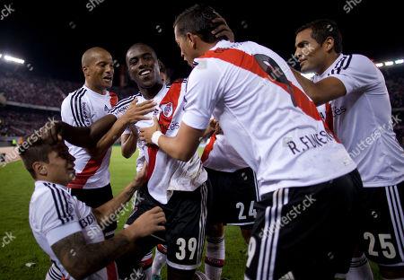 Eder Alvarez Balanta River Plate's Eder Alvarez Balanta, center, celebrates with teammates scoring against Quilmes during an Argentina's league soccer match in Buenos Aires, Argentina