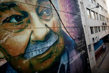 Stock Picture of A mural depicting Argentine writer Ernesto Sabato, created by artist Martin Ron, covers a building there Sabato once lived in Buenos Aires, Argentina. Local painters, including Argentine Martin Ron, take advantage of the relatively lax rules for street art, and they consider local vehicular and pedestrian traffic patterns before painting to get the best exposure for their work