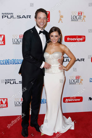 Australian television personality Hamish Blake and wife Zoe Foster arrive for the 2013 Logie Awards at Crown Casino in Melbourne, Australia