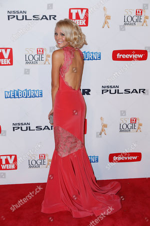 Australian television personality Carrie Bickmore arrives for the 2013 Logie Awards at Crown Casino in Melbourne, Australia