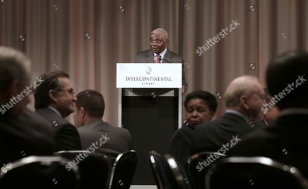 Armando Emilio Guebuza, President of Mozambique, center, delivers a speech during a Mozambique Trade and Investment Breakfast in Sydney, Australia, . President Guebuza is on a 5-day visit to Australia