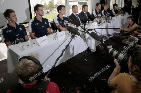 """Stock Picture of Members of Australia Olympic men's relay swim team sit at a table during a press conference in Sydney, Australia, following reports they engaged in disruptive behavior including making prank calls during the Australian team's pre-Olympic games camp in Manchester. Former world swimming champions Magnussen and Eamon Sullivan, and their 4x100-meter relay teammates, face possible sanction from the Australian Olympic Committee after admitting taking the sleeping medication Stilnox during a """"bonding session"""" ahead of last year's London Games. From left:Cameron McEvoy, James Magnussen, Eamon Sullivan, Australian Swimmers Association Chief Executive Daniel Kowalski, Swimming Australia President Barclay Nettlefold, Matthew Targett, James Roberts, Tommaso D'Orsogna"""
