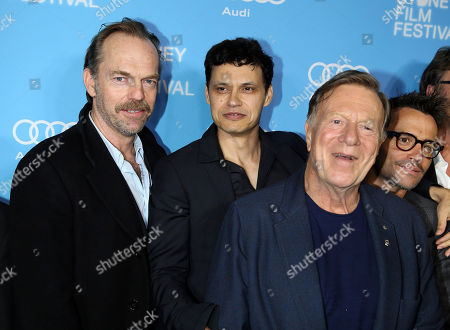 "Jack Thompson, Hugo Weaving, Ivan Sen Damian, Walsh Howling Actor Hugo Weaving, left, poses with director Ivan Sen, second from left, Jack Thompson, front and Damian Walsh Howling during the world premiere of ""Mystery Road"" at the 2013 Sydney Film Festival in Sydney, Australia"