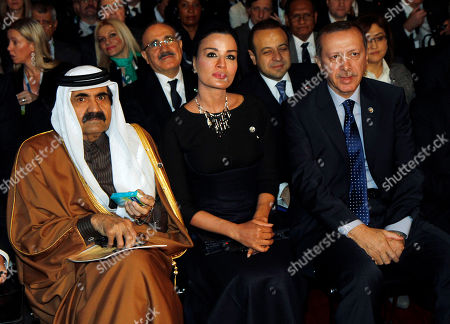 Sheikh Hamad bin Khalifa al-Thani, Mozah bint Nasser Al Missned, Recep Tayyip Erdogan Emir of Qatar Sheikh Hamad bin Khalifa al-Thani, Sheikha Mozah bint Nasser Al Missned and Turkish Prime Minister Recep Tayyip Erdogan, from left, wait for the start of the 5th Global Forum of the United Nations Alliance of Civilizations at the Hofburg palace, in Vienna, Austria, . The forum is meant to bridge differences between the world's cultures
