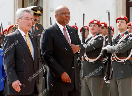 Letsie III, Heinz Fischer Austrian President Heinz Fischer and King Letsie III of Lesotho, from left, review the honor guard during a welcoming ceremony in front of the Hofburg palace in Vienna, Austria