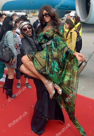 Stock Image of Avo Yermagyan, Yasmine Petty Stylist Avo Yermagyan and model Yasmine Petty pose for photos after arrival at the Vienna International Airport Austria on as guests of the largest annual AIDS charity gala in Europe known as the Life Ball