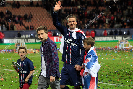 David Beckham Paris Saint-Germain's midfielder David Beckham, center, waves at supporters surrounded by his sons, Brooklyn, second from left, Cruz, left, and Romeo James, right, as he celebrates PSG's French League One title and his final match before retirement, at the Parc des Princes stadium, in Paris. Beckham turns 40 on Saturday May 2, but since retiring, England's former captain continues to prosper off the field, where his multi-faceted life centers on celebrity and fashion, but also ambassadorial roles and an ambitious project to create a Miami team in the increasingly popular Major League Soccer