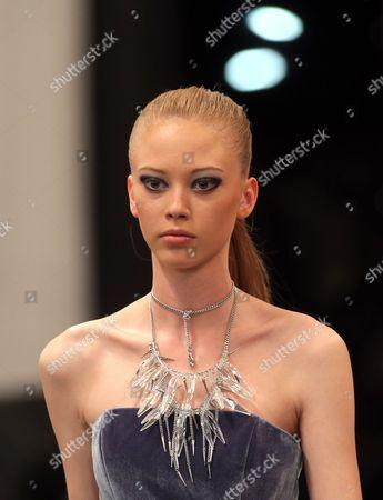 A model displays a creation by fashion designer Dmitry Sholokhov for O.Jen during Belarus Fashion Week in Minsk, Belarus