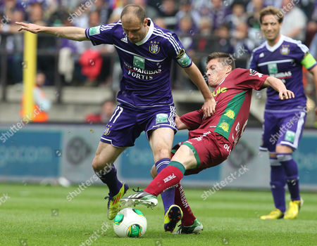 Milan Jovanovic, Jonathan Delaplace SV Zulte Waregem Jonathan Delaplace, right, is challenged by RSC Anderlecht's Milan Jovanovic, during the final of the Belgian League soccer match at the Constant Vanden Stock stadium in Brussels
