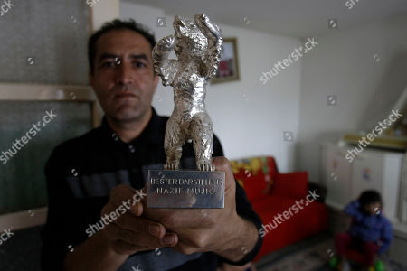 Nazif Mujic Nazif Mujic, the Gypsy scrap metal collector shows his award - the Silver Bear for best actor of the 63rd Berlin Film Festival at his home in the village of Poljice, 150 kms northeast of Sarajevo, on . People in the Gypsy village of Poljice say they will never forget the night they almost fell off their chairs two months ago. Did they really hear the elegant woman on TV correctly? Could she really be talking about their neighbor, the toothless man who passed his days selling scrap metal and lived in the shack down the road? The camera switched to a frightened-looking Najif Mujic. Yes it was him. THEIR Nazif _ who had just left Matt Damon and Jude Law in the dust to win the best actor award at the Berlin Film Festival