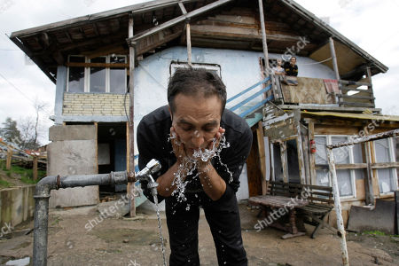 Nazif Mujic The unexpected movie star, Nazif Mujic, washes his face in front of his home in the village of Poljice,150 kms northeast of Sarajevo, on . People in the Gypsy village of Poljice say they will never forget the night they almost fell off their chairs two months ago. Did they really hear the elegant woman on TV correctly? Could she really be talking about their neighbor, the toothless man who passed his days selling scrap metal and lived in the shack down the road? The camera switched to a frightened-looking Najif Mujic. Yes it was him. THEIR Nazif _ who had just left Matt Damon and Jude Law in the dust to win the best actor award at the Berlin Film Festival