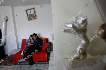 Nazif Mujic Gypsy actor Nazif Mujic hugs his daughter Sandra in the living room where his Best Actor award - the Silver Bear - decorates the shelf of his shabby home in the village of Poljice, 150 kms northeast of Sarajevo, on . People in the Gypsy village of Poljice say they will never forget the night they almost fell off their chairs two months ago. Did they really hear the elegant woman on TV correctly? Could she really be talking about their neighbor, the toothless man who passed his days selling scrap metal and lived in the shack down the road? The camera switched to a frightened-looking Najif Mujic. Yes it was him. THEIR Nazif _ who had just left Matt Damon and Jude Law in the dust to win the best actor award at the Berlin Film Festival