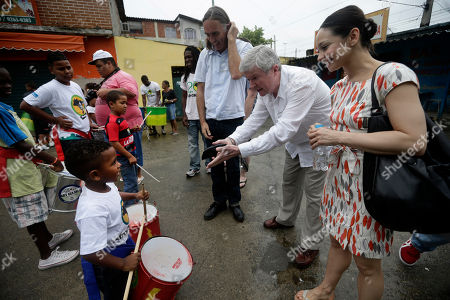 Roberta Marquez, Anthony William Hall Royal Opera House Chief Executive Anthony William Hall, second from right, and Brazilian dancer of London's Royal Ballet Roberta Marquez, right, greet children as they visit the Afro Reggae cultural center in the Vigario Geral slum of Rio de Janeiro, Brazil, . This past week Royal Ballet dancers shared their knowledge and advice with promising artists during an education symposium between the company and the cultural arts center Afro Reggae
