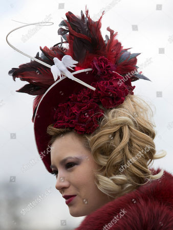 Milliner Mimi Theobald from Inverness wears one of her creations during Ladies' Day at Aintree Racecourse Liverpool, England