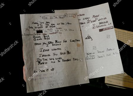 Hand written lyrics by Dennis Wilson for a song called 'End of the Show' is displayed in London, . A large archive collection of The Beach Boys early compositions, contracts, publishing agreements, hand written songs and hand written musical manuscripts will be auctioned this month in one lot. The archive is being auctioned by closed bidding by The Fame Bureau in London, bids are accepted up to May 15
