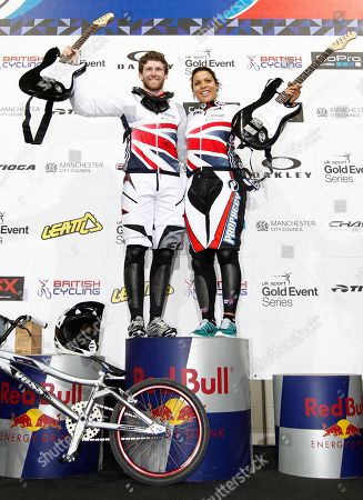 Britain's Liam Phillips, left, and Shanaze Reade pose for pictures after winning the Men and Women Elite competitions at the BMX Supercross World Championships, Manchester, England