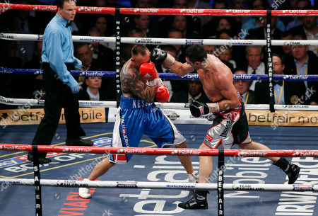 Carl Froch, Mikkel Kessler Carl Froch of Britain, right, fights against Mikkel Kessler of Denmark during their super-middleweight world title unification boxing match at O2 Arena in London