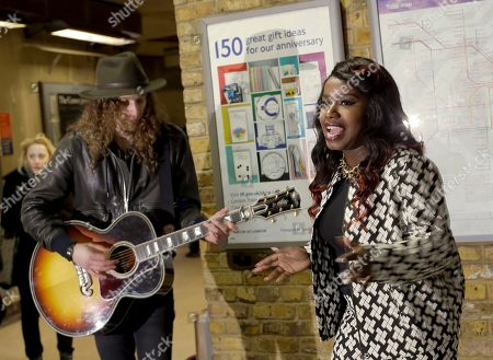 """Misha B and Josh Osho play during a media event to promote """"Gig 2012' the annual busking competition for buskers on the London Underground train network in London, Tuesday, March, 26, 2013. The competition gives talented young musicians the opportunity to win a converted year long busking license on the underground, singer Misha B used busking to overcome her stage fright, before finding fame on the British X Factor TV show"""