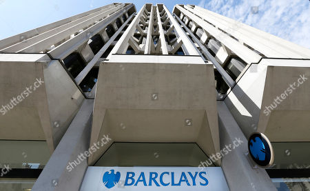 A branch of Barclays Bank in London. Barclays, Britain's second-biggest bank in terms of assets, is to slash up to 12,000 jobs as it seeks to change its corporate culture following a string of scandals. But even as the reductions were announced Tuesday Feb. 11, 2014, Barclays set aside more money for bonuses. The bonus pool rose by 210 million pounds in 2013 - a move Chief Executive Antony Jenkins defended despite the fact the bank's performance worsened in the fourth quarter