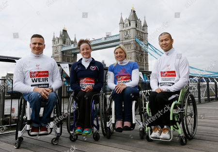 Elite wheelchair athletes Britain's David Weir, left, United States' Tatyana McFadden, second left, Britain's Shelly Woods, second right, and Japan's Hiroyuki Yamamoto, right, pose for the media in front of Tower Bridge in London, . The London Marathon will go ahead on Sunday despite security fears in the wake of the bomb blasts in the Boston race that killed at least three runners and injured many more