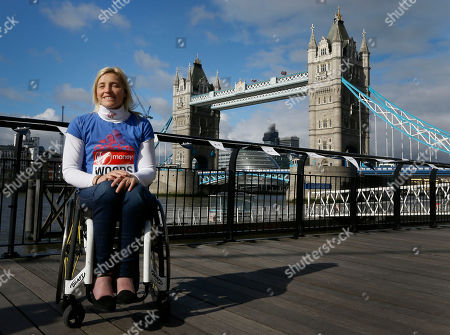 British elite wheelchair athlete Shelly Woods poses for the media in front of Tower Bridge in London, . The London Marathon will go ahead on Sunday despite security fears in the wake of the bomb blasts in the Boston race that killed at least three runners and injured many more