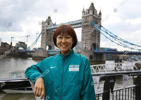 Japan's elite athlete Yoko Shibui poses for the media in front of Tower Bridge in London, . The London Marathon will go ahead on Sunday despite security fears in the wake of the bomb blasts in the Boston race that killed at least three people and injured many more